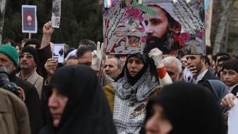TEHRAN, IRAN - JANUARY 08: Worshippers attend a rally to protest the execution of Sheikh Nimr al-Nimr January 8, 2016 in Tehran, Iran. Sheikh Nimr al-Nimr, a prominent opposition Saudi Shiite cleric, was executed in Saudi Arabia on January 2nd, along with 47 other men. Thousands of worshippers who took part in Friday prayers joined a rally to protest the execution, carrying pictures of al-Nimr and chanting 'Death to Al Saud,' referencing the kingdom's royal family. According to local state media, similar protests took place in other Iranian cities and towns. (Photo by Majid Saeedi/Getty Images)