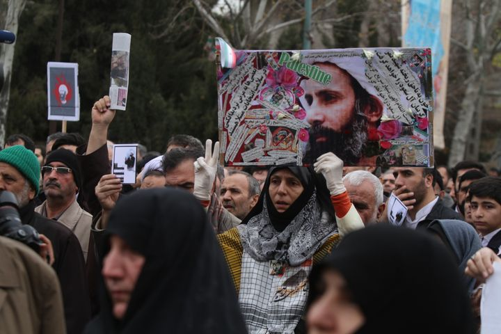 Worshipers attend a rally to protest the execution of Sheikh Nimr al-Nimr in Tehran, Iran.
