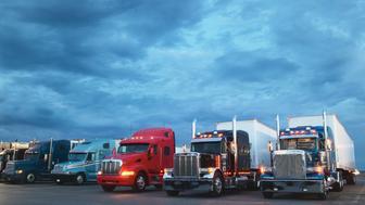 Semi-trucks parked at  truck stop, dawn