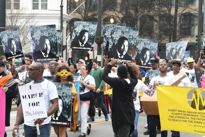 Marchers in Atlanta know whom the federal holiday honors on Monday: Martin Luther King Jr.