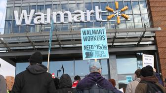 WASHINGTON, DC - NOVEMBER 28:  Protesters gather in front of a Walmart store in the nations capital Friday to demand better wages in Washington, DC on November 28,2014. (Photo by Muhammed Bilal Kenasari/Anadolu Agency/Getty Images)