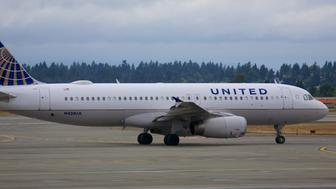Seattle, Washington - June 1, 2015: United is an American major airline headquartered in Chicago, Illinois. It is the world's largest airline when measured by number of destinations served.