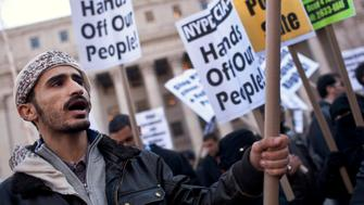 Hamzah Ali protests during a rally at Foley Square in New York November 18, 2011. Ali is protesting against the reportedly heavy-handedness of New York Police Department (NYPD) and Central Intelligence Agency (CIA) on Muslim communities and neighbourhoods in New York, New Jersey and Pennsylvania, according to media reports. The protesters were joined by people affiliated with Occupy Wall Street. REUTERS/Andrew Burton (UNITED STATES - Tags: BUSINESS CIVIL UNREST RELIGION POLITICS)