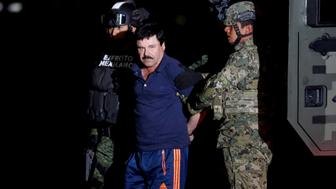 "FILE PHOTO - Joaquin ""El Chapo"" Guzman is escorted by soldiers during a presentation in Mexico City, January 8, 2016. One of Guzman's sons, Alfredo, 29, was among a group of people abducted from a restaurant in the Mexican tourist resort of Puerto Vallarta on August 15, 2016, said Jalisco's Attorney General. REUTERS/Tomas Bravo/File Photo"