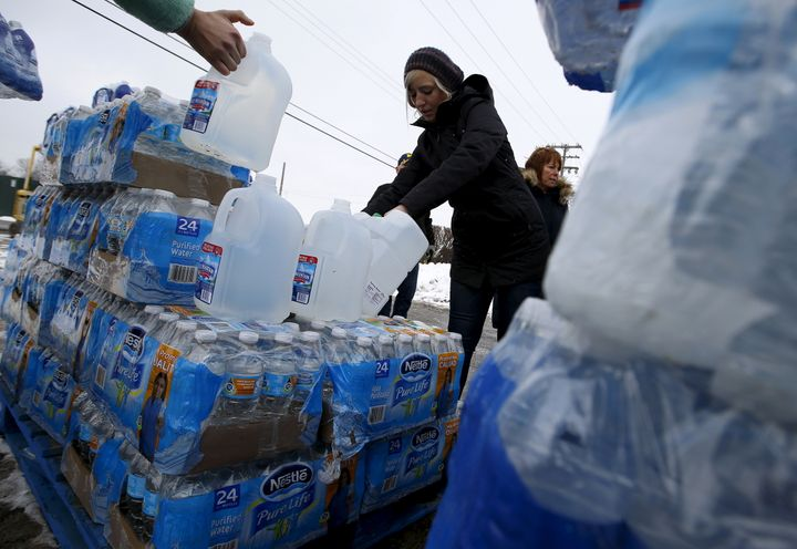 Volunteers distribute bottled water to help combat the effects of the crisis when the city's drinking water became contaminated with dangerously high levels of lead in Flint, Michigan, March 5, 2016.