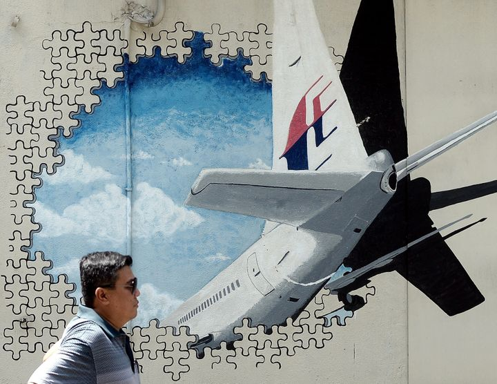 A mural of Malaysia Airlines Flight MH370 was painted on a back alley wall in Shah Alam, Malaysia. On Tuesday, the searc