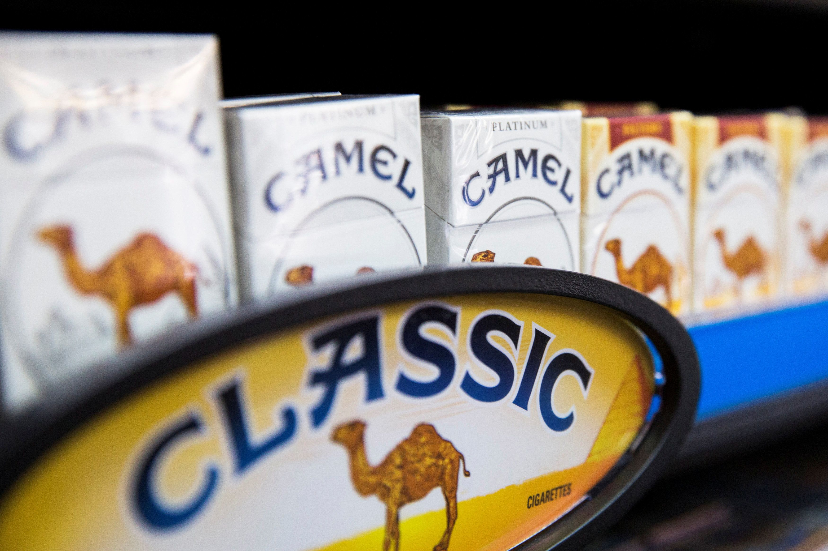 Camel cigarettes are stacked on a shelf inside a tobacco store in New York July 11, 2014.   REUTERS/Lucas Jackson/File Photo     TPX IMAGES OF THE DAY