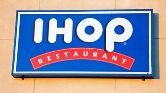 'Chicago, Illinois, USA - September 21, 2011: IHOP (The International House of Pancakes) restaurant sign seen on the wall of the building in Chicago. IHOP was founded in 1958.'