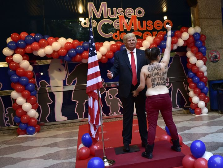 A topless feminist activist grabbed a Donald Trump waxwork in the crotch area during its unveiling at the Madrid Wax Mus