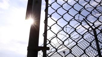 """Chain link fence and concertina wire surrounds Joint Task Force Guantanamo's Camp Delta at the U.S. Naval Base in Guantanamo Bay, Cuba March 22, 2016.  REUTERS/Lucas Jackson SEARCH """"GUANTANAMO BAY"""" FOR THIS STORY. SEARCH """"THE WIDER IMAGE"""" FOR ALL STORIES. ??"""