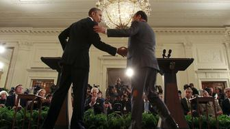 U.S. President Barack Obama (L) greets French President Francois Hollande during a joint news conference in the East Room of the White House in Washington November 24, 2015. REUTERS/Carlos Barria