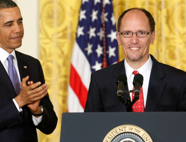 President Barack Obama applauds Tom Perez, his then-nominee for labor secretary, at the White House on March 18, 2013. Obama