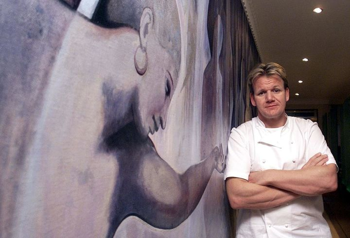 British Chef Gordon Ramsey stands at the entrance to his Chelsea restaurant in London in January 2001, after being awarded th
