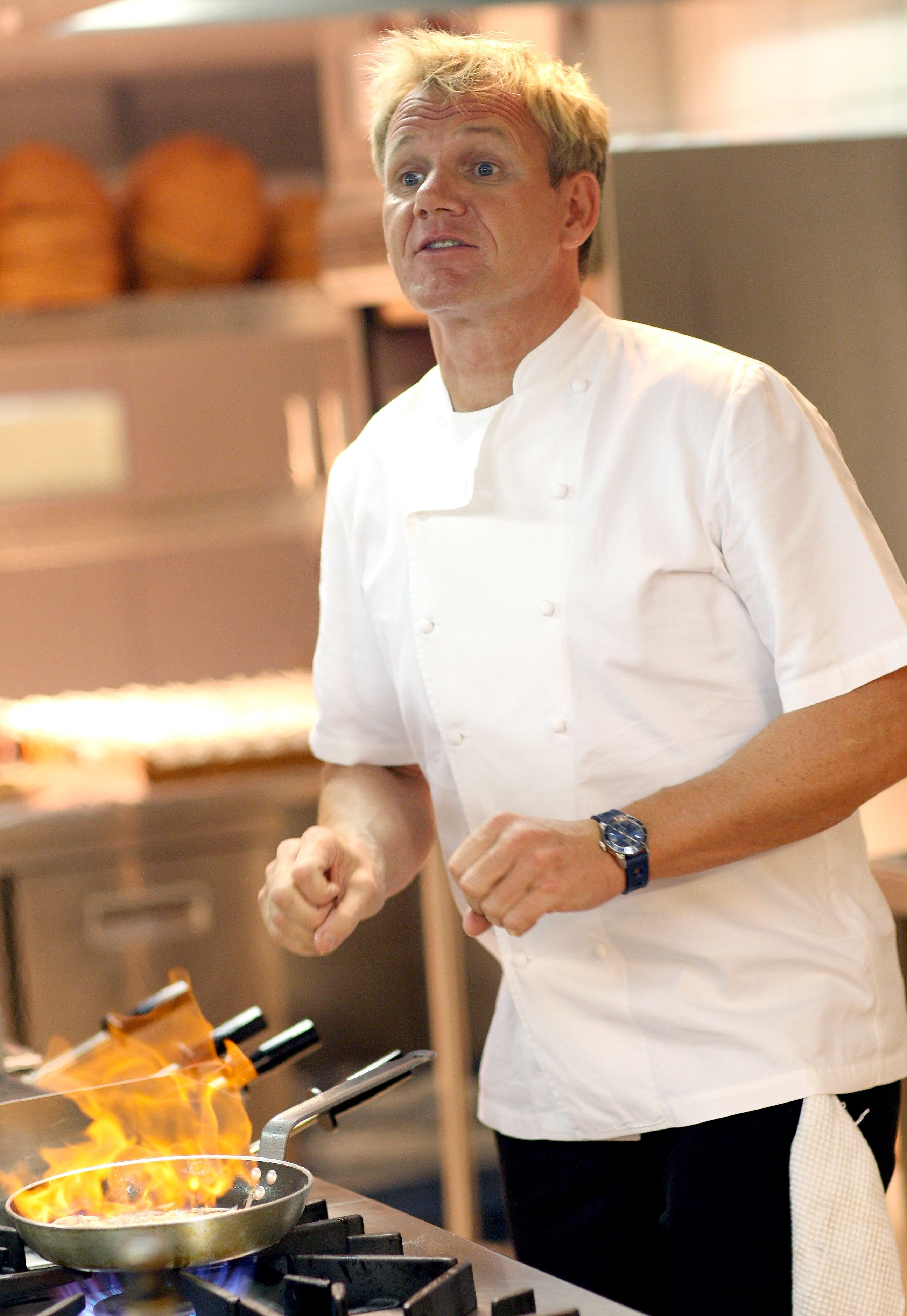 CAPE TOWN, SOUTH AFRICA - APRIL 02:  Celebrity Chef Gordon Ramsey prepares the food for the opening party in his maze Restaurant at the new One&Only Cape Town resort on April 2, 2009 in Cape Town, South Africa. Today is the Grand Opening of Sol Kerzner's first hotel in his home country since 1992. The 130 room property is One&Only's first Urban resort and sits in the fashionable Waterfront district. Celebrities from all over the world including Mariah Carey, Clint Eastwood, Matt Damon, Morgan Freeman, Thandie Newton, Marisa Tomei will attend the event. Gordon Ramsay will be launching his first restaurant in Africa at the resort, Maze and Robert De Niro will be opening Nobu. Nelson Mandela will be attending an intimate luncheon at Maze on Friday to celebrate his long-standing relationship with Mr. Kerzner.  (Photo by Chris Jackson/Getty Images)