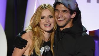 SAN DIEGO, CA - JULY 09:  Co-hosts/actors Bella Thorne (L) and Tyler Posey perform onstage during the MTV Fandom Fest San Diego Comic-Con at PETCO Park on July 9, 2015 in San Diego, California.  (Photo by Ethan Miller/Getty Images)