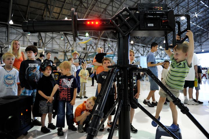 """Geoffrey Boden, 4, tries out a laser gun while visiting """"Star Wars at the Hanger"""" at Wings Over the Rockies Air & Space M"""