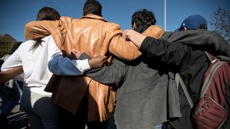 COLUMBIA, MO - NOVEMBER 13: Concerned Student 1950 group supporters hug during a march through University of Missouri campus on November 13, in Columbia, Missouri. The 'We Are Not Afraid' March started near Black Culture Center and ended in the central building, Jesse Hall.