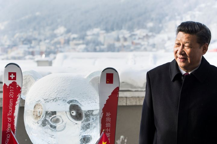 Chinese President Xi Jinping stands next to a panda ice sculpture as he launched the Swiss-Sino year of tourism with Swiss Pr