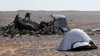 The debris from a Russian airliner is seen at its crash site at the Hassana area in Arish city, north Egypt, November 1, 2015. Egyptian authorities have detained two employees of Sharm al-Sheikh airport in connection with the downing of a Russian jet on October 31, killing all 224 people on board, two security officials said on November 17, 2015. Picture taken November 1, 2015. REUTERS/Mohamed Abd El Ghany      TPX IMAGES OF THE DAY