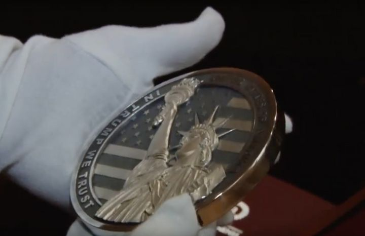 "The coin's opposite side features the Statue of Liberty and the engraved line: ""In Trump We Trust."""