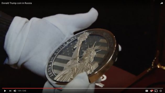 The coin's opposite side features the Statue of Liberty and the engraved line:
