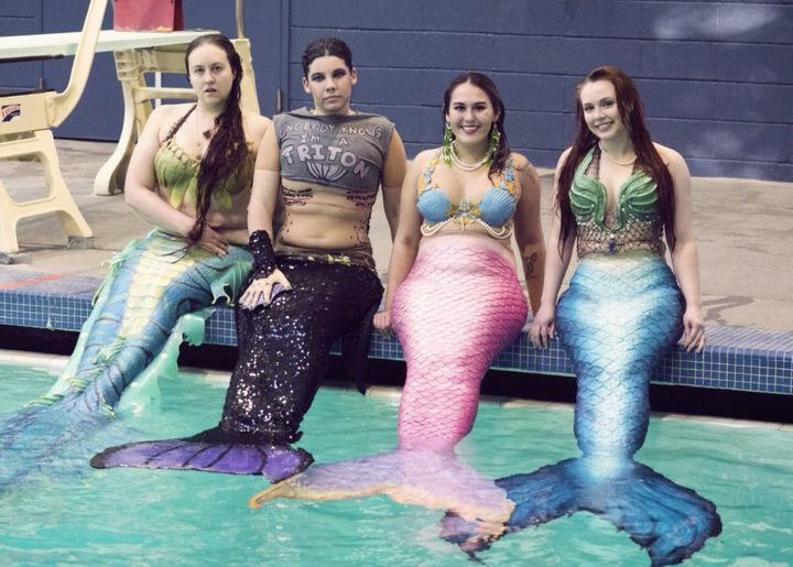 As members of Seattle's mermaid community, Caitlin Nielsen, Ed Brown, Tessie LaMourea and Morgan Caldwell (L-R) get alo