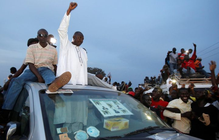 Supporters of Gambia'sUnited Democratic Party opposition alliance cheer for candidate Adama Barrow during a rally in Ba