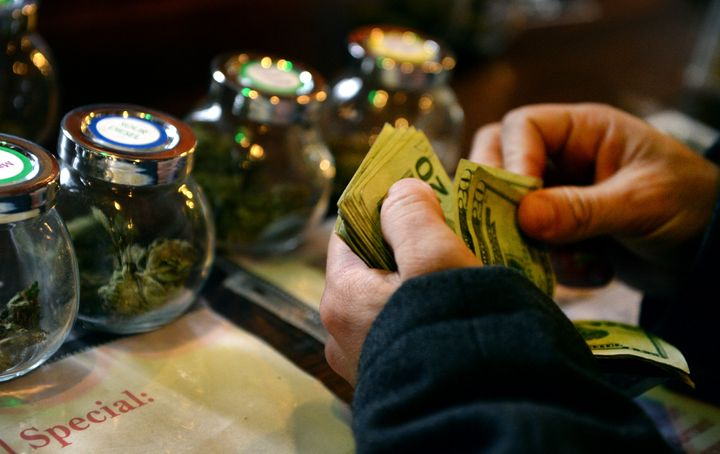A customer purchases marijuana at a dispensary in Denver in 2014.