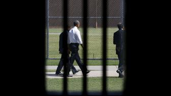 Photographed through a prison cell window, U.S. President Barack Obama tours the El Reno Federal Correctional Institution in El Reno, Oklahoma July 16, 2015.  Obama is the first sitting president to visit a federal prison.      REUTERS/Kevin Lamarque
