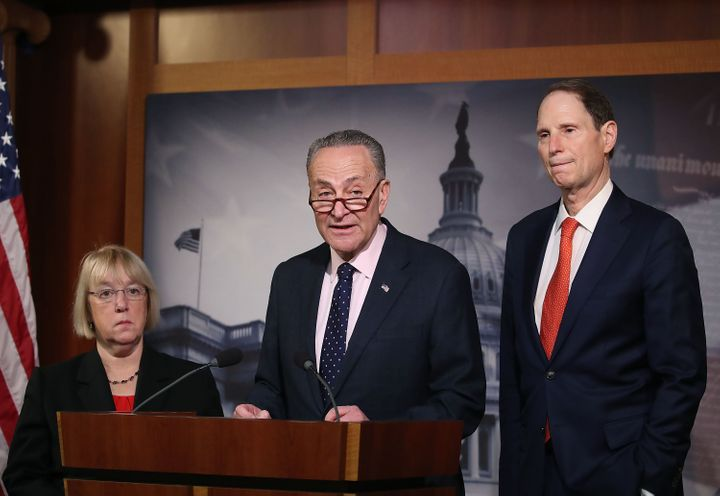 Senate Minority Leader Charles Schumer (D-NY) (C), speaks while flanked by Sen. Patty Murray (D-WA),(L), and Sen. Ron Wyden (