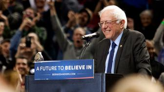 PORTLAND, OR - MARCH 25: A bird lands on Democratic presidential candidate Bernie Sanders podium as he speaks on March 25, 2016 in Portland, Oregon. Sanders spoke to a crowd of more than eleven thousand about a wide range of issues, including getting big money out of politics, his plan to make public colleges and universities tuition-free, combating climate change and ensuring universal health care.  (Photo by Natalie Behring/Getty Images)