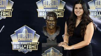 Aug 8, 2015, Canton, OH, USA; Sydney Seau poses with the bust of her late father Junior Seau at the 2015 Pro Football Enshrinement Cermony at Tom Benson Hall of Fame Stadium. Mandatory Credit: Andrew Weber-USA TODAY Sports
