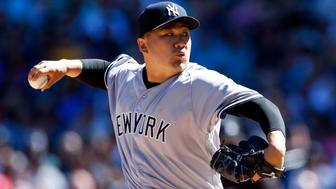 Aug 24, 2016; Seattle, WA, USA; New York Yankees starting pitcher Masahiro Tanaka (19) throws against the Seattle Mariners during the second inning at Safeco Field. Mandatory Credit: Joe Nicholson-USA TODAY Sports