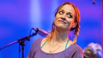American singer-songwriter Fiona Apple performs with the Watkins Family Hour Band during a performance in celebration of the 50th anniversary of Bob Dylan's 'Highway 61 Revisited' album at the Lincoln Center Out of Doors AmericanaFest NYC at Damrosch Park Bandshell, New York, New York, August 8, 2015. Visible in the background is drummer Don Heffington. The concert featured a song-by-song performance of Dylan's album in its entirety. (Photo by Jack Vartoogian/Getty Images)