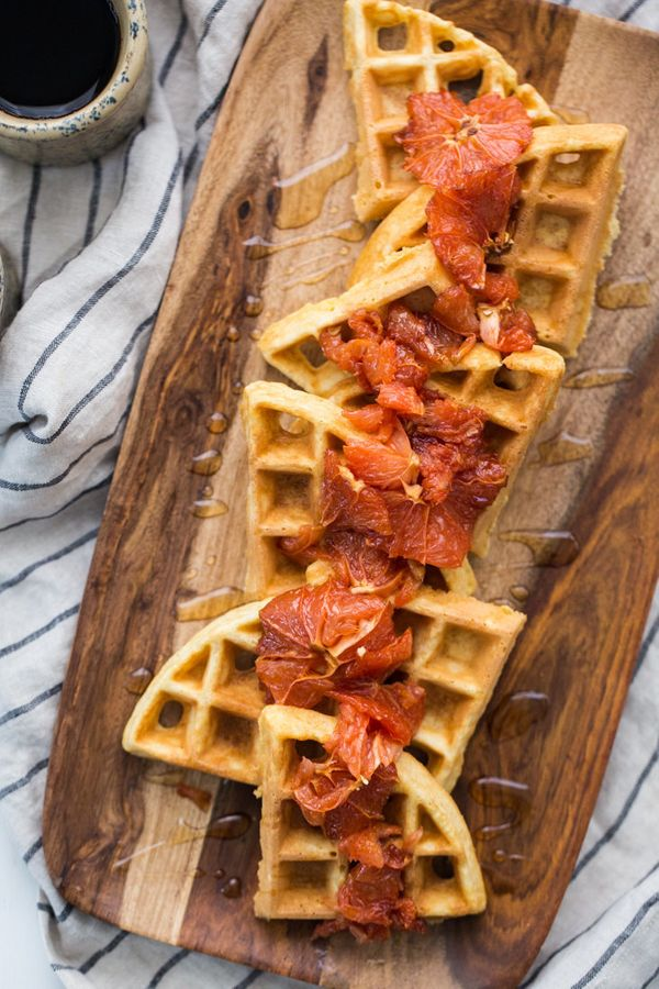 "<strong>Get the <a href=""https://naturallyella.com/cornbread-waffles-with-roasted-grapefruit-from-the-easy-vegetarian-kitchen"
