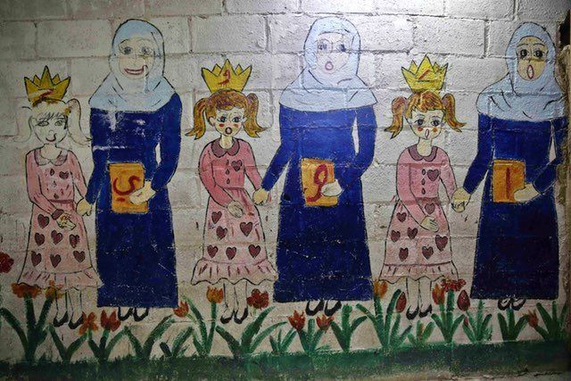 A mural in one of the underground rooms of the Al-Hayat school in Damascus northeastern rebel-held al-Qaboun suburb