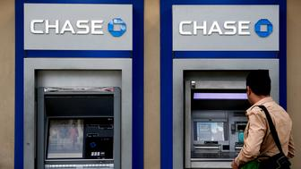 A customer uses a JPMorgan Chase & Co. automatic teller machine (ATM) outside a bank branch in Miami Beach, Florida, U.S., on Wednesday, Jan. 11, 2017. JPMorgan Chase & Co. is scheduled to release earnings figures on January 13. Photographer Scott McIntyre/Bloomberg via Getty Images
