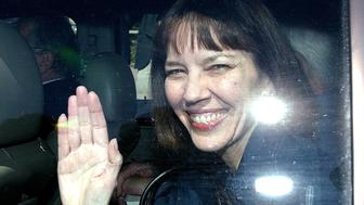 New York Times reporter Judith Miller waves as she leaves U. S. District Court in Washington Friday, Sept. 30, 2005, after testifying to a grand jury investigating the leaking of a CIA operatives identity. Miller served three months in jail for earlier refusing to divulge her source in the matter. (AP Photo/Dennis Cook)