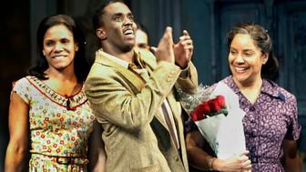"Cast members from the play ""A Raisin In The Sun"" come out for a curtain call at the end of the play in New York, April 26, 2004. Actress Phylicia Rashad (R) Sean Combs and Audra McDonald (L) star in the new Broadway production of the classic play. REUTERS/Jeff Christensen  JC"