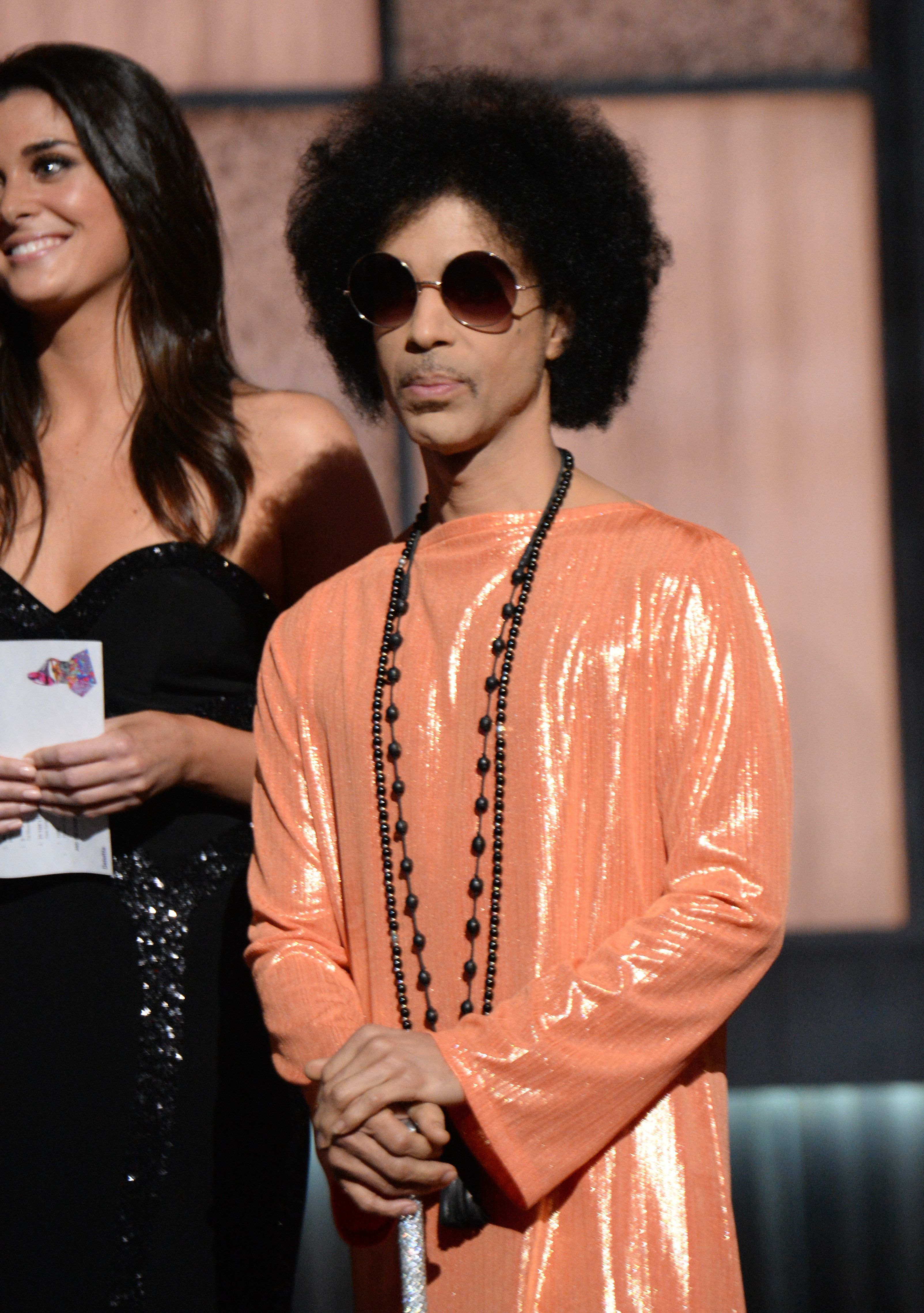 LOS ANGELES, CA - FEBRUARY 08:  Prince presents award  onstage during The 57th Annual GRAMMY Awards at the STAPLES Center on February 8, 2015 in Los Angeles, California.  (Photo by Kevin Mazur/WireImage)