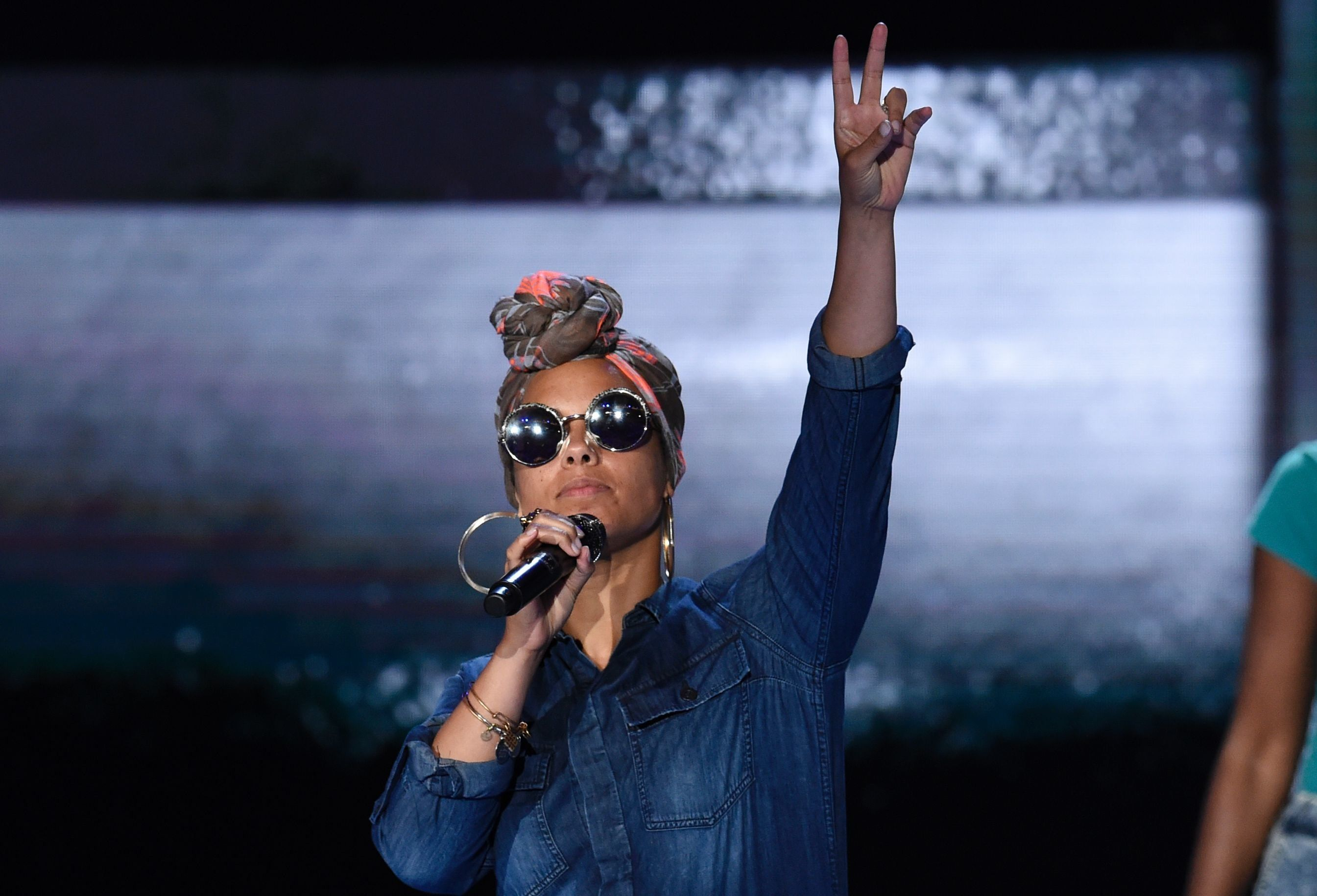 Alicia Keys rehearses on stage prior to the start of Day 2 of the Democratic National Convention at the Wells Fargo Center in Philadelphia, Pennsylvania, July 26, 2016. / AFP / SAUL LOEB        (Photo credit should read SAUL LOEB/AFP/Getty Images)