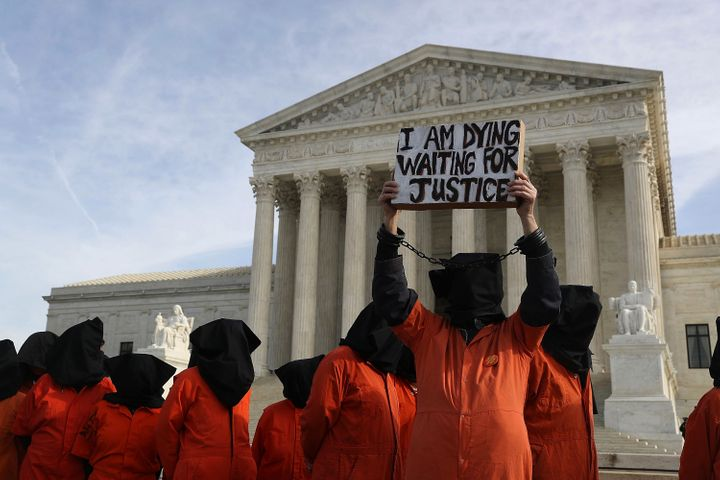 Protesters gather in front of the U.S. Supreme Court to mark 15 years since the first prisoners were brought to the U.S. dete