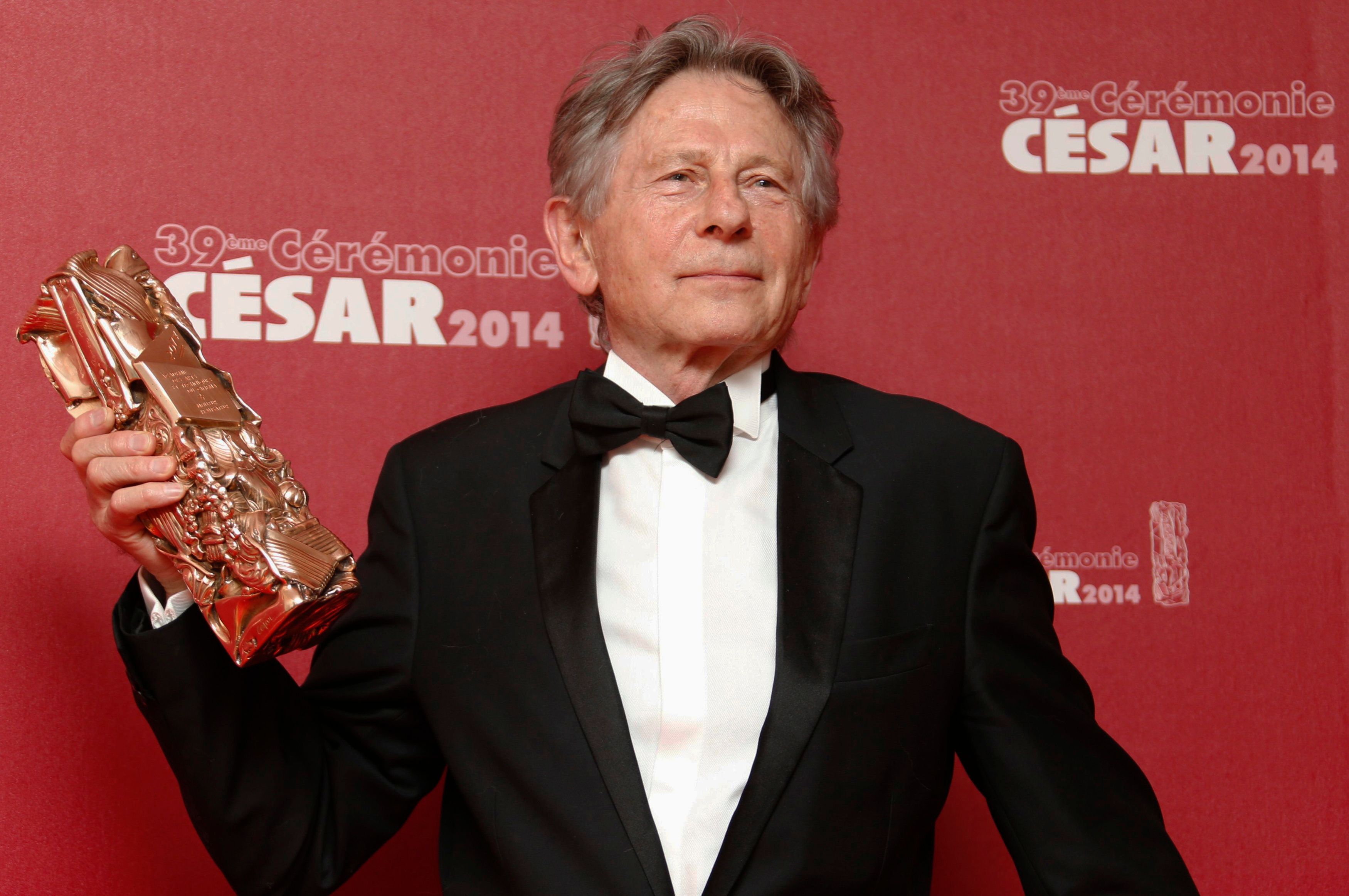 "Director Roman Polanski poses with his Best Director award for ""La Venus A La Fourrure"" (Venus in Fur) during a photocall at the 39th Cesar Awards ceremony in Paris February 28, 2014. REUTERS/Regis Duvignau (FRANCE - Tags: ENTERTAINMENT TPX IMAGES OF THE DAY)"