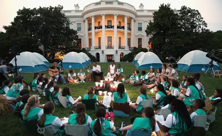 Barack and Michelle Obama hosted a group of Girl Scouts from across the country for a campout on the the White House South Lawn in June 2015.