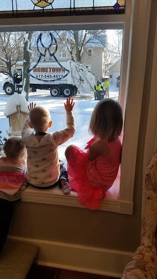 Angie Sevenson's three daughters, who are 2, 3 and 5 years old, adore waving to their local garbage men.