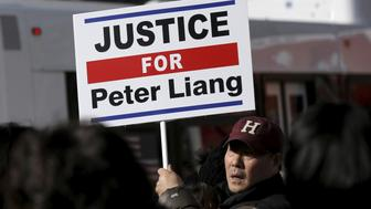 Protesters hold a rally in support of former NYPD officer Peter Liang in the Brooklyn borough of New York February 20, 2016. Liang was convicted of manslaughter and official misconduct on Thursday for fatally shooting an unarmed black man, Akai Gurley, in a darkened public housing stairwell in 2014, according to media reports.  REUTERS/Brendan McDermid