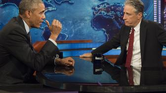 US President Barack Obama speaks with Jon Stewart, host of 'The Daily Show with Jon Stewart,' during a taping of the show in New York, July 21, 2015. The appearance marks Obama's third time on the show as President, and seventh overall. AFP PHOTO / SAUL LOEB        (Photo credit should read SAUL LOEB/AFP/Getty Images)