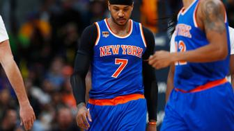 New York Knicks forward Carmelo Anthony (7) in the second half of an NBA basketball game Saturday, Dec. 17, 2016, in Denver. The Nuggets won 127-114. (AP Photo/David Zalubowski)