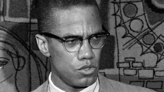 FILE - This March 12, 1964 file photo, Malcolm X addresses reporters at the Hotel Park-Sheraton in New York. Malcolm Xs family and estate said rapper-singer Nicki Minajs use of the black nationalist with a rifle in his hands, juxtaposed with a racial slur, for her single artwork is disrespectful and offensive. In an exclusive statement to The Associated Press on Friday, Feb. 14, 2014, Malcolm Xs daughter, Ilyasah Shabazz, said Minajs use of the picture is in no way is endorsed by my family. (AP Photo, File)
