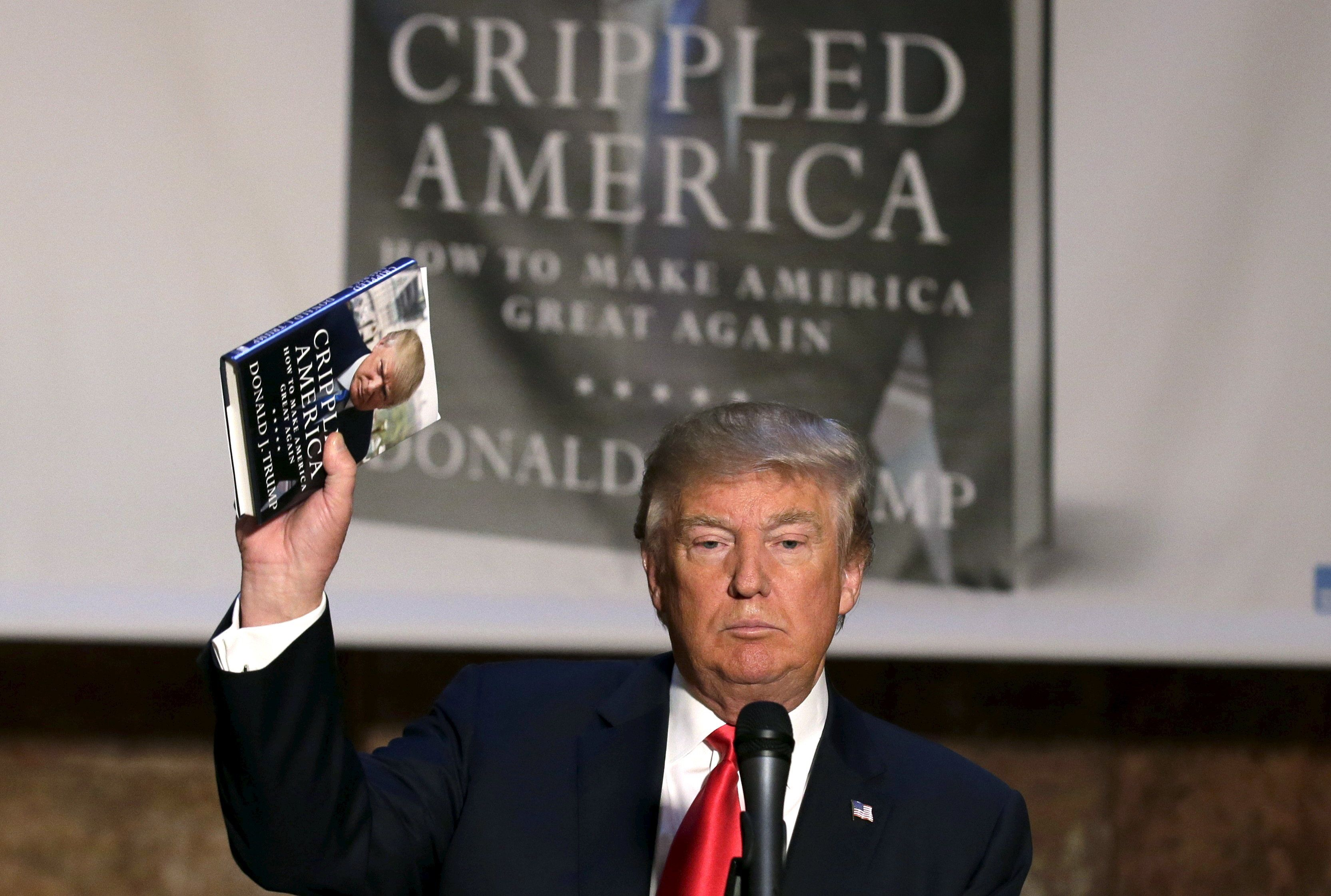 "Republican presidential candidate Donald Trump holds up a copy of his new book ""Crippled America"" at news conference to promote the book in the Manhattan borough of New York City, November 3, 2015.  REUTERS/Brendan Mcdermid      TPX IMAGES OF THE DAY           TPX IMAGES OF THE DAY"